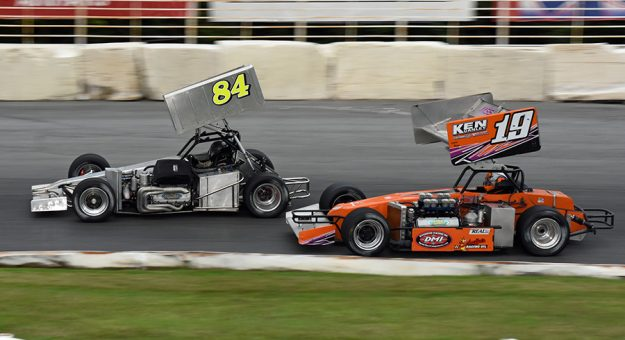 Mike Lichty (84) leads Trent Stephens Saturday at Oswego Speedway. (Jim Feeney Photo)