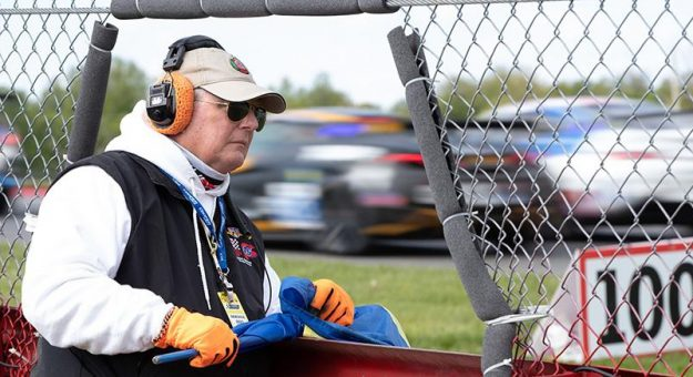 Corner workers get closer to the action than almost any other person in motorsports. (IMSA Photo)