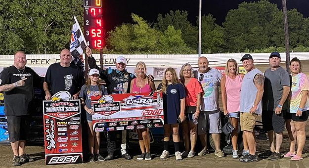 Joe Duvall in victory lane at Creek County Speedway.
