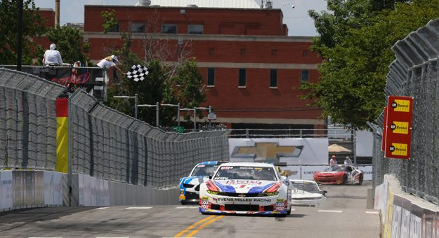 Mike Skeen takes the checkered flag to win Saturday's Trans-Am Series TA2 event on the streets of Nashville.