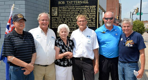 Dee Tattersall is joined (from left to right) by Streator Mayor Jimmie Lansford, IRMA members Mark Eutsler, Bob Gates, Rick Dennison and midget racing champion Kevin Olson during the unveiling of the IRMA Bob Tattersall marker in Streator, Ill., on Tuesday. (Stan Kalwasinski Photo)