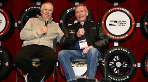 Robin Miller (left) interviews Bobby Unser at the PRI Trade Show. (IndyCar Photo)