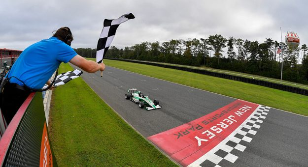 Reece Gold takes the checkered flag Saturday at New Jersey Motorsports Park.
