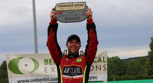 Brooks Clark holds up the granite trophy for winning the 43rd Optical Expressions Berlin Labor Day Classic at Thunder Road. (Alan Ward photo)