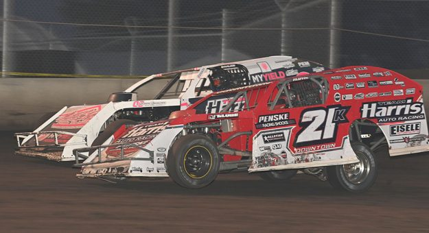 Kyle Brown (21k) makes the race winning pass during the Fast Shafts Modified All-Star Invitational at Boone Speedway. (Tom Macht Photo)
