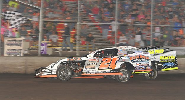 Riley Simmons (21R) edges Dallon Murty at the finish line to win the first of two IMCA Modified prelim features Friday at Boone Speedway. (Tom Macht Photo)