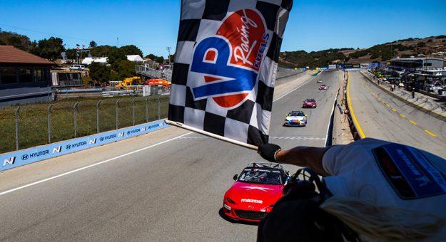 Gresham Wagner takes the checkered flag Saturday at WeatherTech Raceway Laguna Seca.