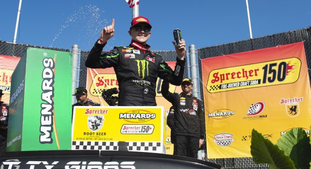 Ty Gibbs, driver of the No. 18 Joe Gibbs Racing Toyota,  celebrates in victory lane after winning the Sprecher 150 for the ARCA Menards Series at the Milwaukee Mile in West Allis, Wisconsin, on Aug. 29, 2021. (Patrick McDermott/ARCA Racing)