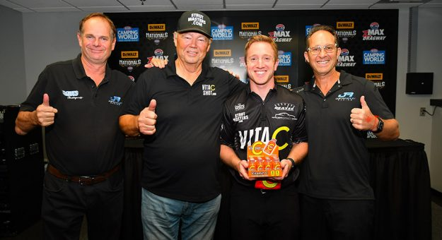 Justin Ashley Racing Marketing Director Roch Bailey, Chip Lofton, Justin Ashley and Mike Ashley after the announcement that Vita C Shot would sponsor Justin Ashley in the NHRA Top Fuel category. (Ron Lewis Photo)