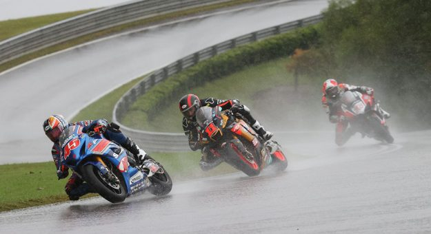 Cameron Petersen (45) battled with fellow South African Mathew Scholtz (11) and Loris Baz (76) in the early laps of the Superbike race. (Brian J. Nelson Photo)