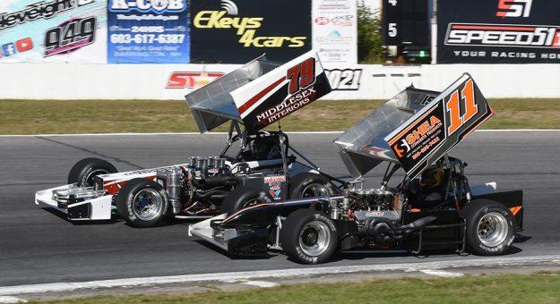 Chris Perley (11) battles Jon McKennedy Sunday at Star Speedway. (Jim Feeney Photo)