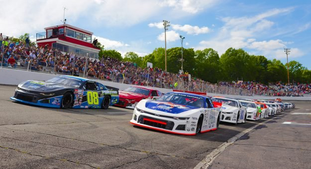 A strong field of cars, which includes many Battle of the Stars invitees, lined up on the grid prior to the start of the Old North State Nationals CARS Tour race at Orange County Speedway in April 2021. (Andy Marquis photo)
