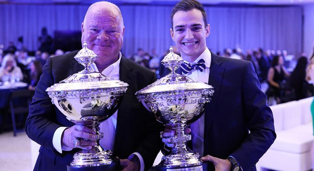 Chip Ganassi and Alex Palou each received miniature versions of the Astor Challenge Cup during the IndyCar Victory Lap Celebration. (IndyCar Photo)